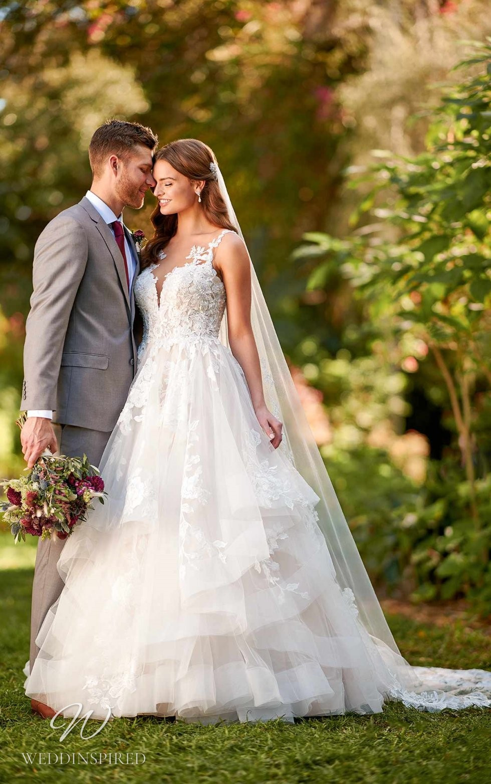 An Essense of Australia lace and tulle A-line wedding dress with a layered ruffle skirt