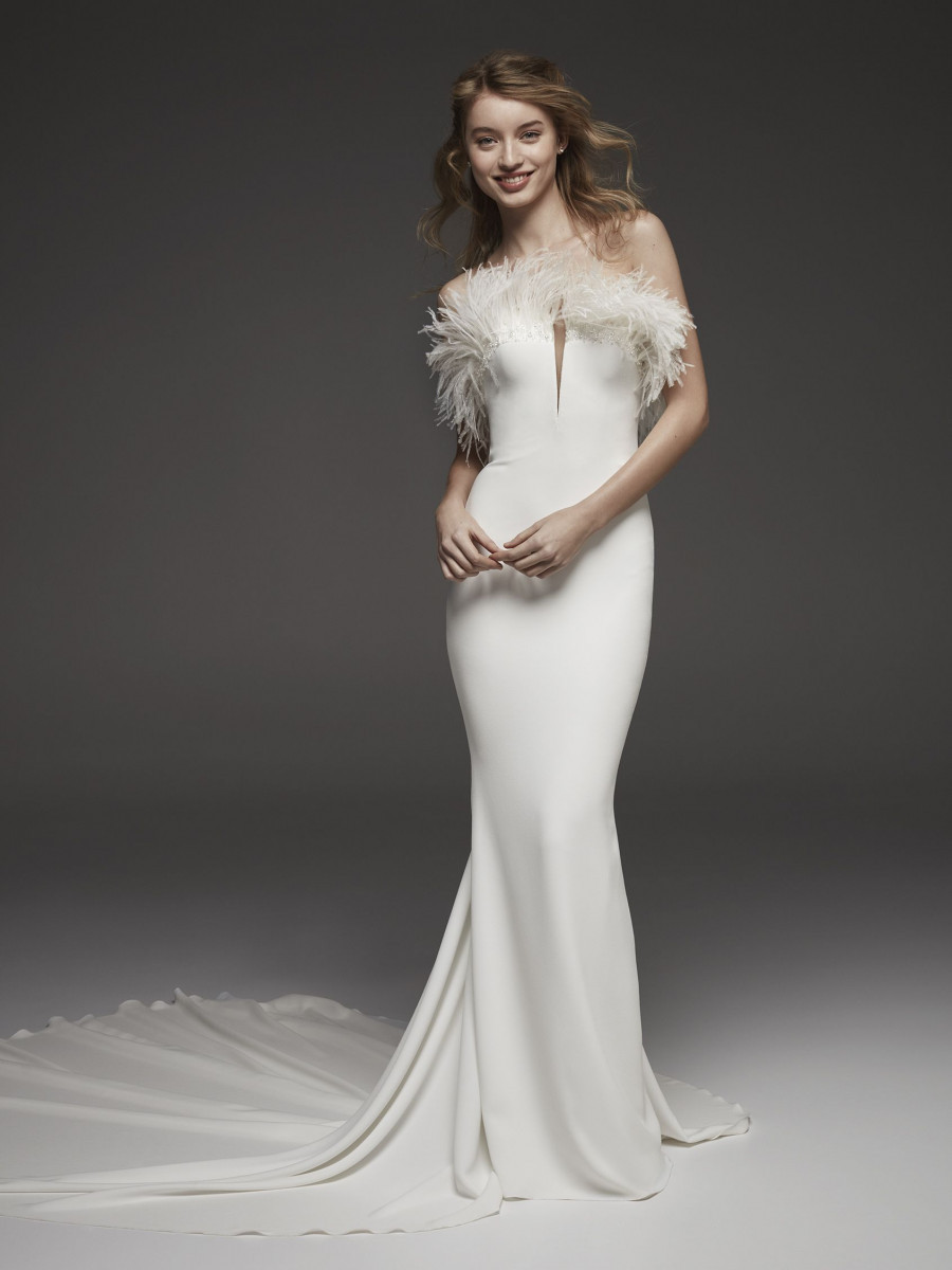 A Pronovias strapless crepe and feathers mermaid wedding dress