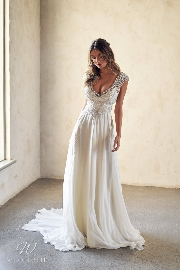 An Anna Campbell 2020 A-line chiffon wedding dress with a v neckline, beading and short sleeves
