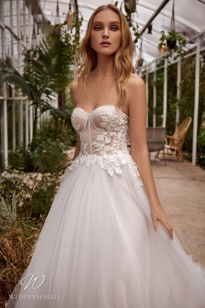 A Julie Vino 2021 ivory strapless lace and tulle ball gown wedding dress