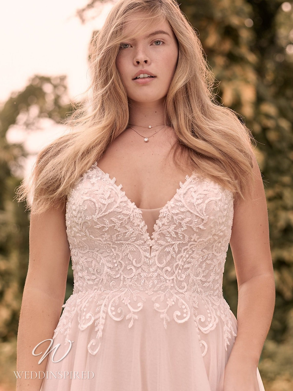 A Rebecca Ingram Spring 2021 blush lace and mesh A-line wedding dress with straps and a v neck