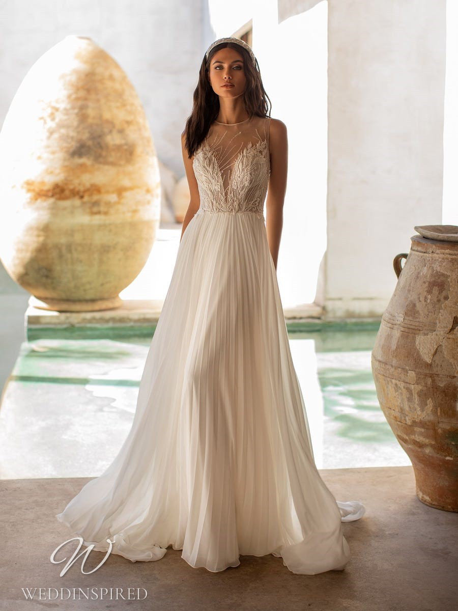 A Pronovias 2021 pleated A-line wedding dress with an illusion neckline