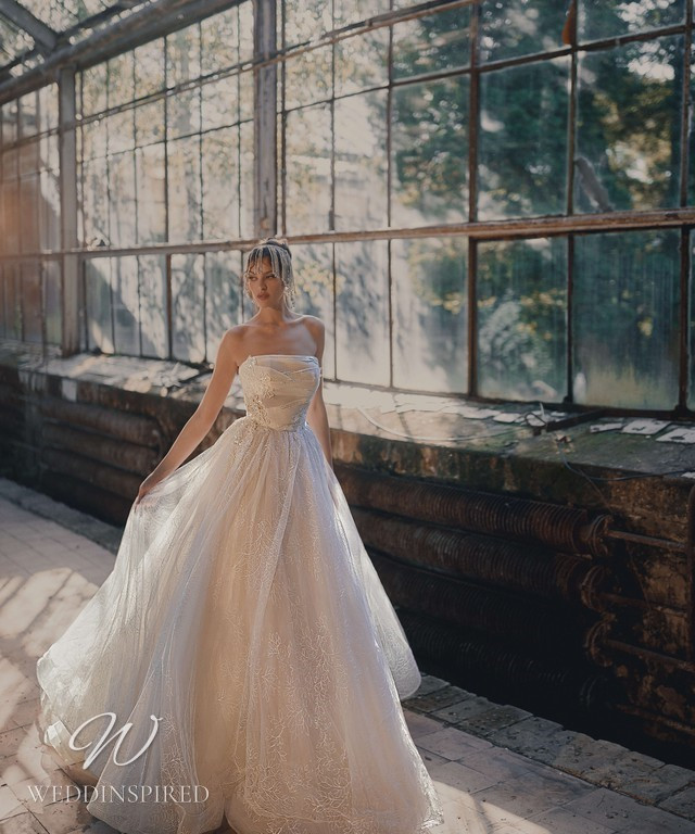 An Ange Etoiles 2021 strapless ivory tulle ball gown wedding dress