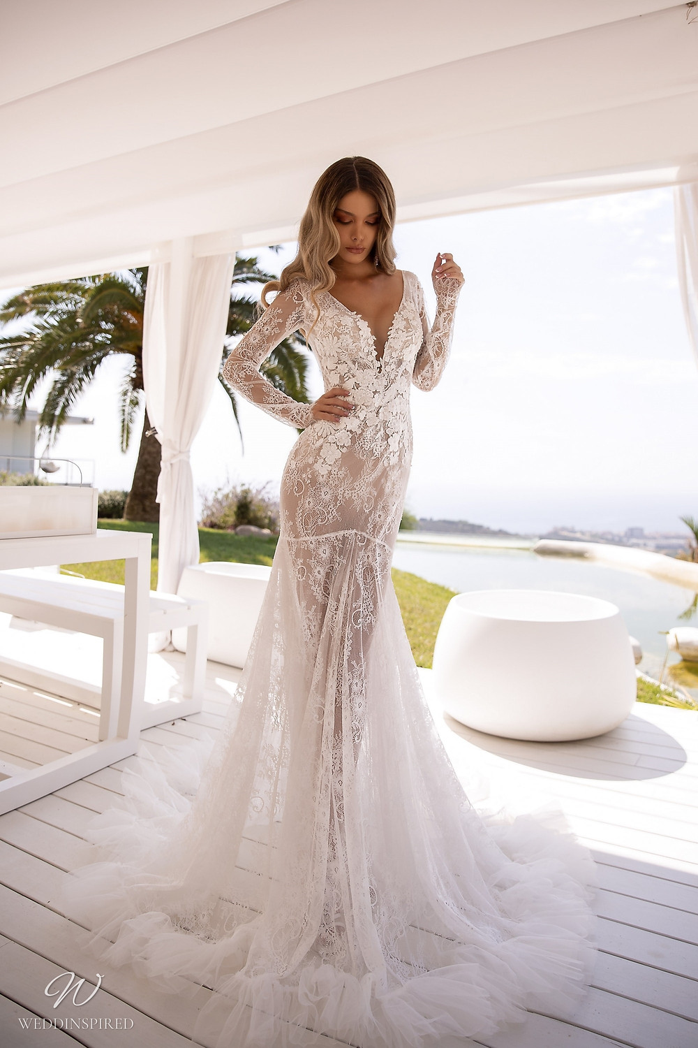 A Tina Valerdi lace fit and flare wedding dress with long sleeves and a low neckline