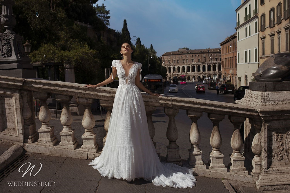 A Pinella Passaro lace A-line wedding dress with a low neckline and cap sleeves