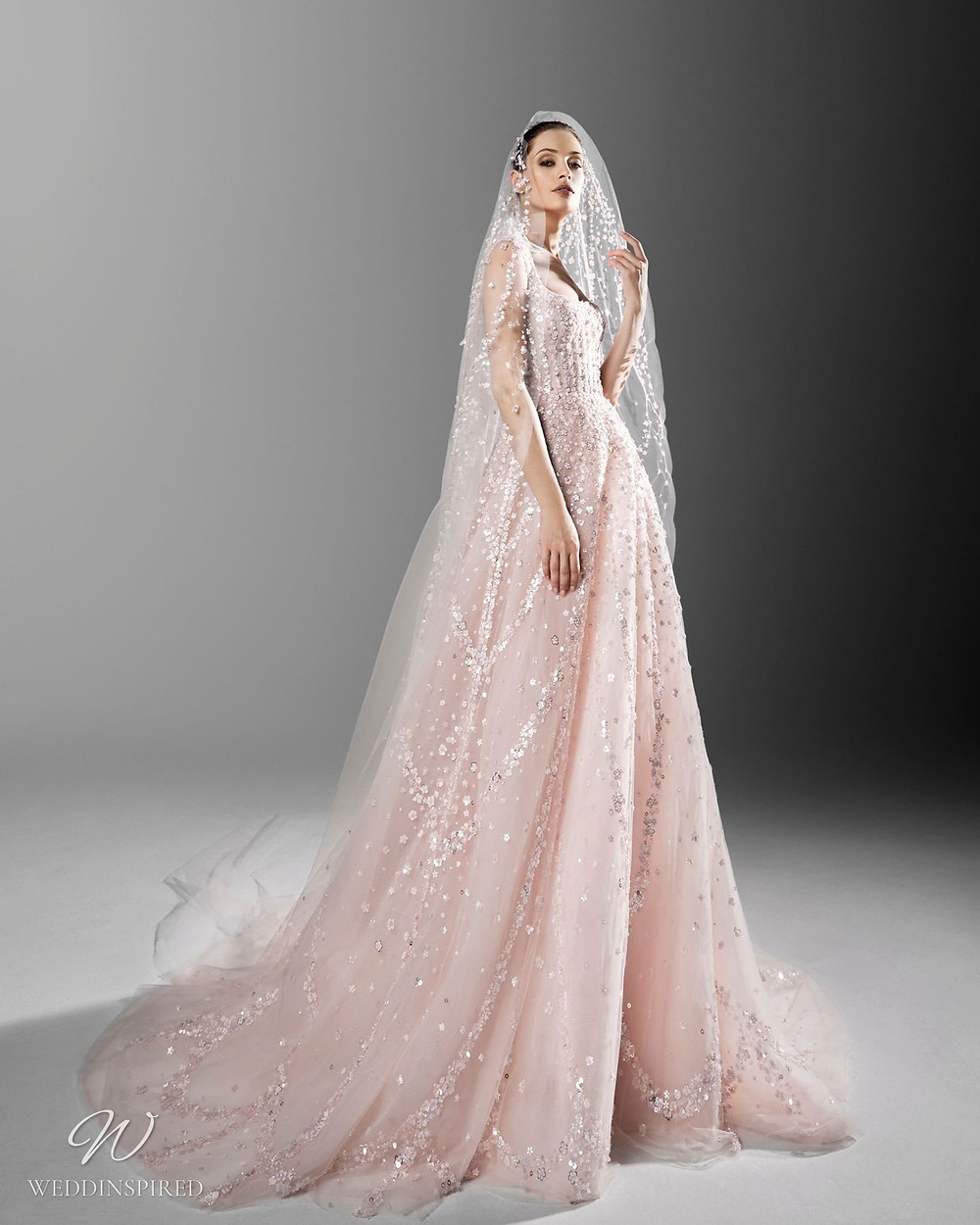 A Zuhair Murad romantic blush ball gown wedding dress with crystals, sparkles and a veil