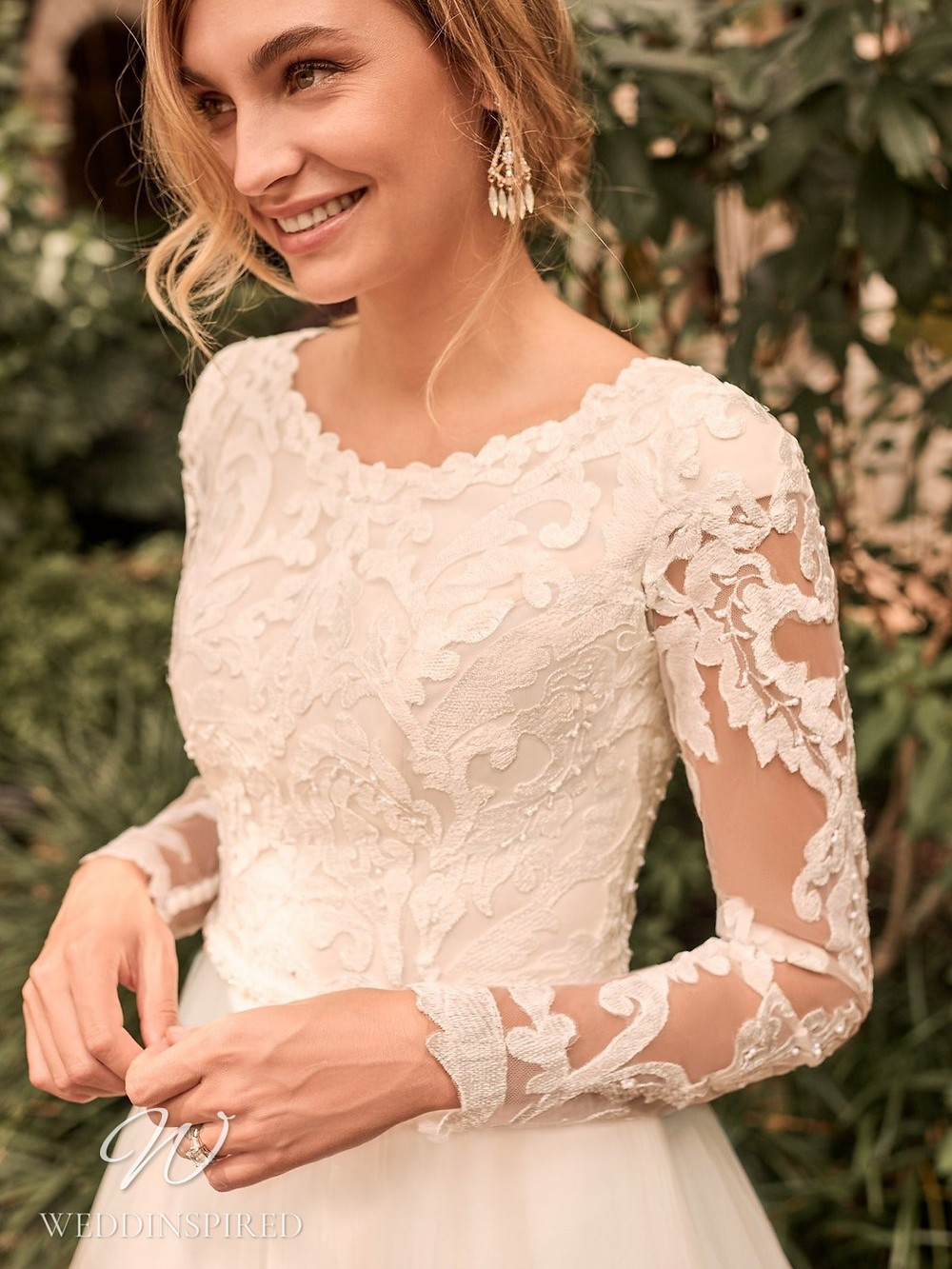 A Rebecca Ingram Spring 2021 lace A-line wedding dress with long illusion sleeves