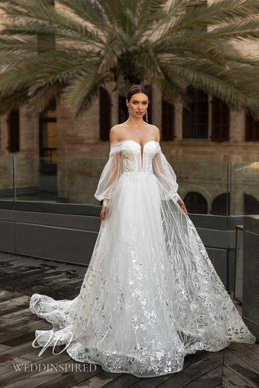 An Ida Torez 2021 off the shoulder gypsy boho tulle A-line wedding dress with a sweetheart neckline