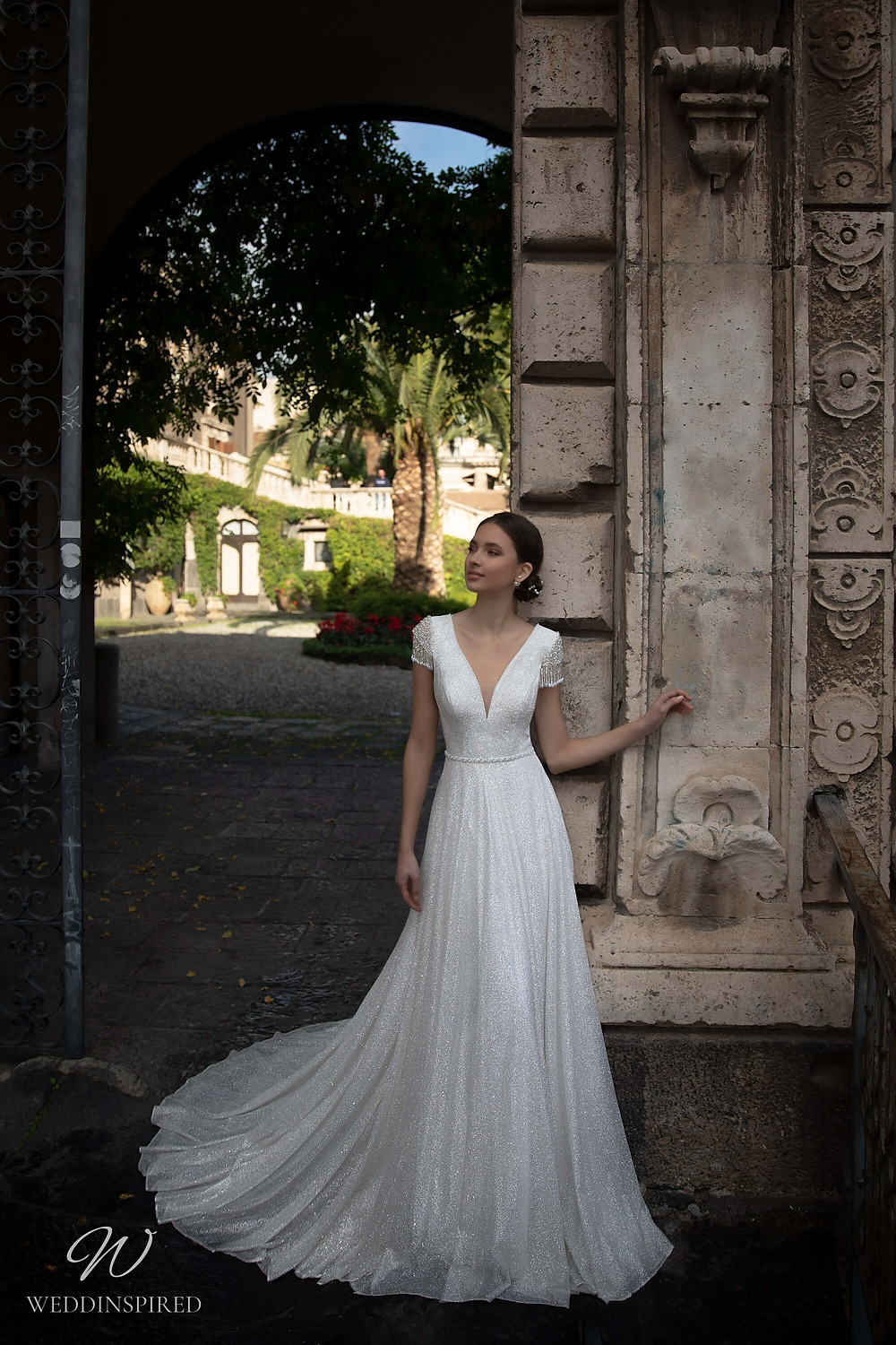 A Naviblue sparkly A-line wedding dress with fringe cap sleeves