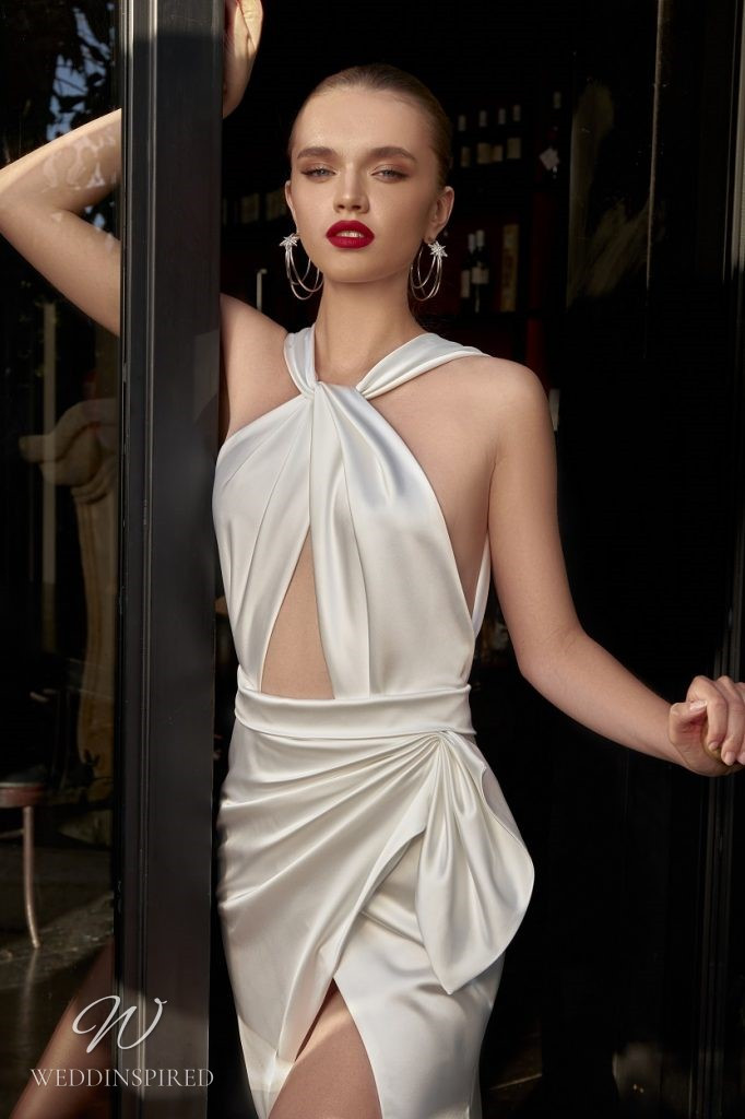 A Julie Vino 2021 sexy silk fitted halterneck wedding dress with a high slit