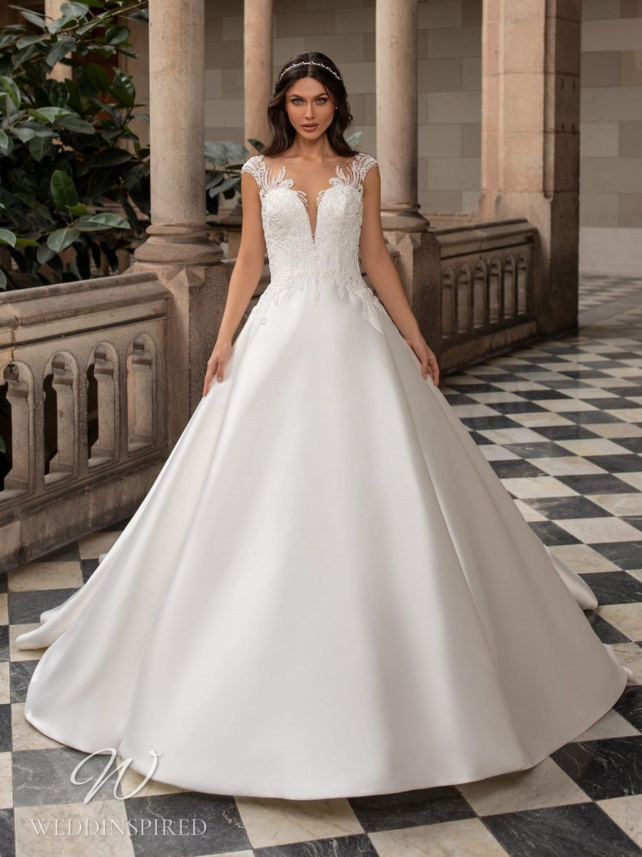 A Pronovias 2021 lace and satin princess ball gown wedding dress with cap sleeves