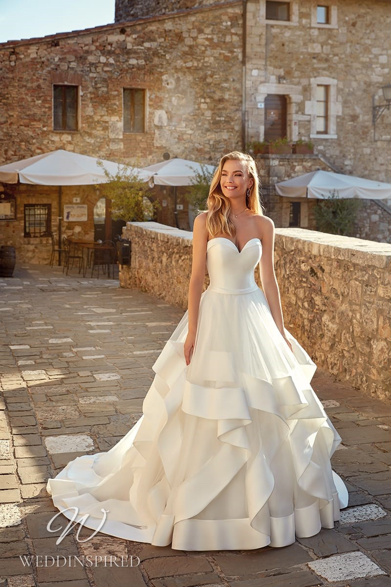 An Eddy K 2021 strapless satin and tulle A-line wedding dress
