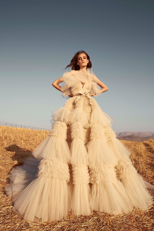 A Zuhair Murad tan blush tulle ball gown wedding dress with layered ruffle skirt