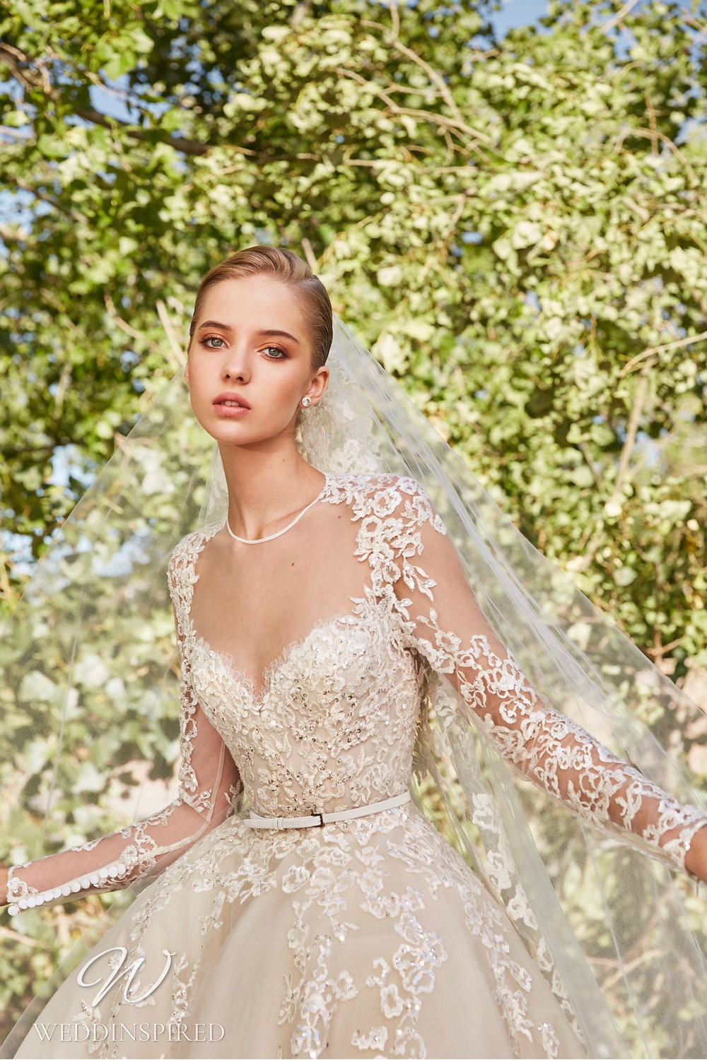 An Elie Saab Spring 2021 ivory lace princess ball gown wedding dress with long illusion sleeves