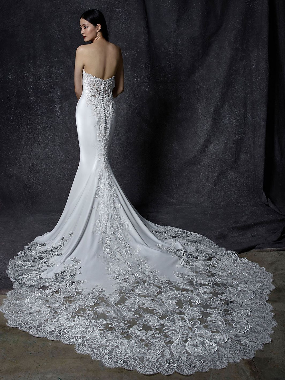 An Enzoani strapless silk wedding dress with lace and a long train