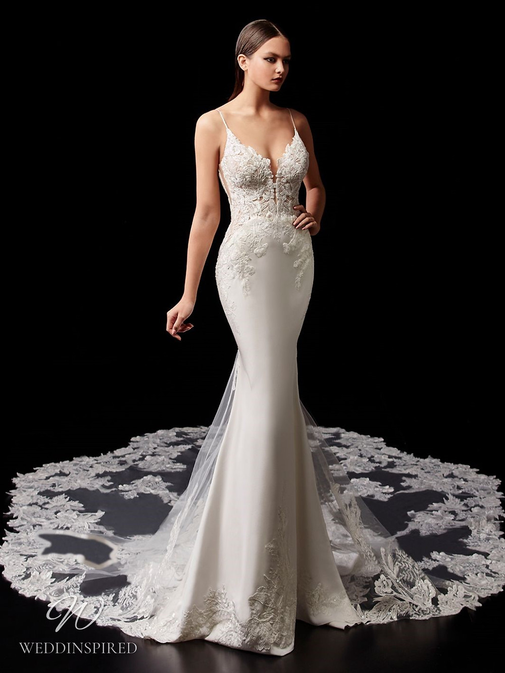 An Enzoani lace mermaid wedding dress with thin straps and an illusion train