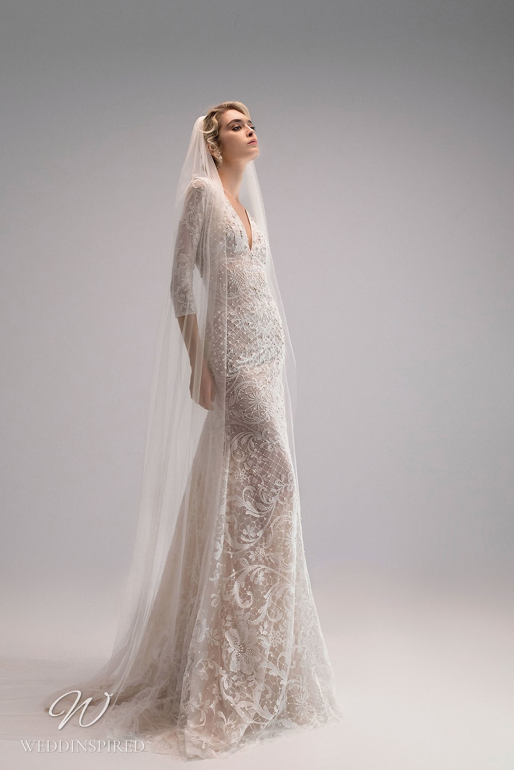An Ersa Atelier 2021 lace A-line wedding dress with half sleeves and beading