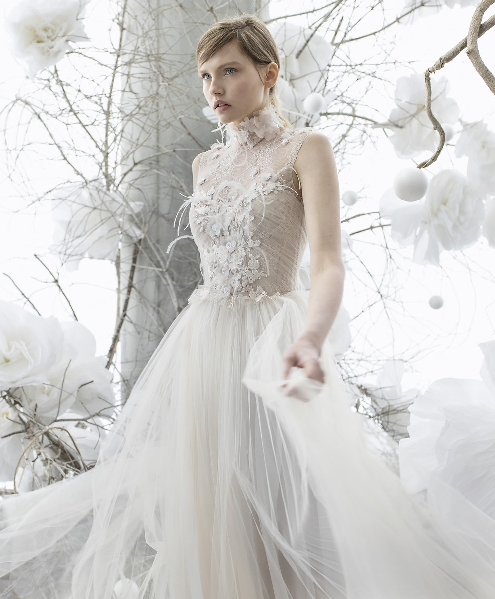A Mira Zwillinger mesh, chiffon and feathers A-line wedding dress