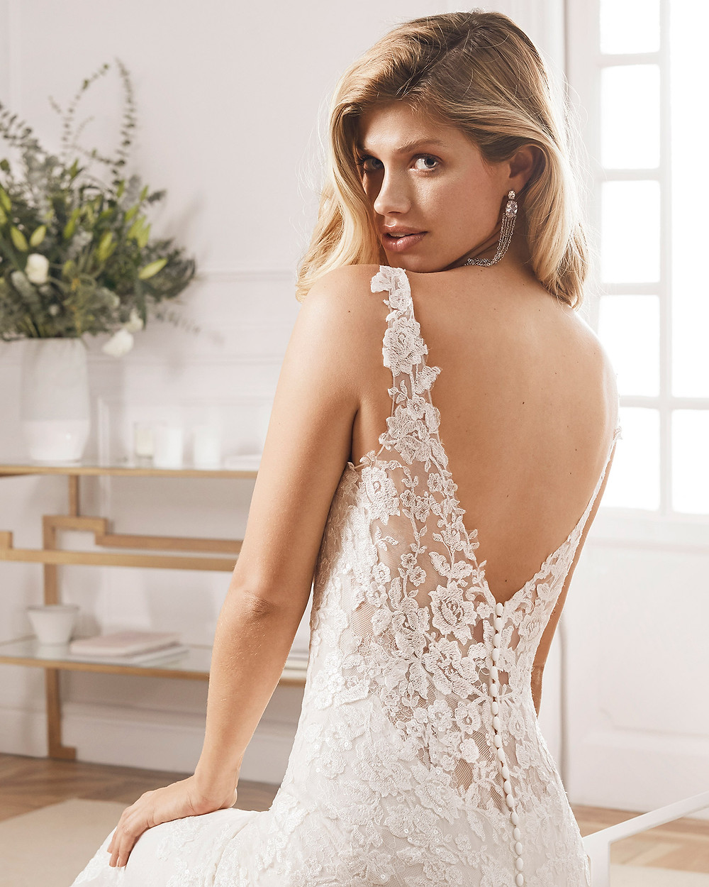 An Aire Barcelona 2020 lace mermaid fit and flare wedding dress with a low back