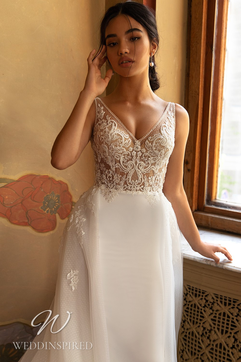 A WONÁ Concept 2021 lace and satin mermaid wedding dress with a v neck