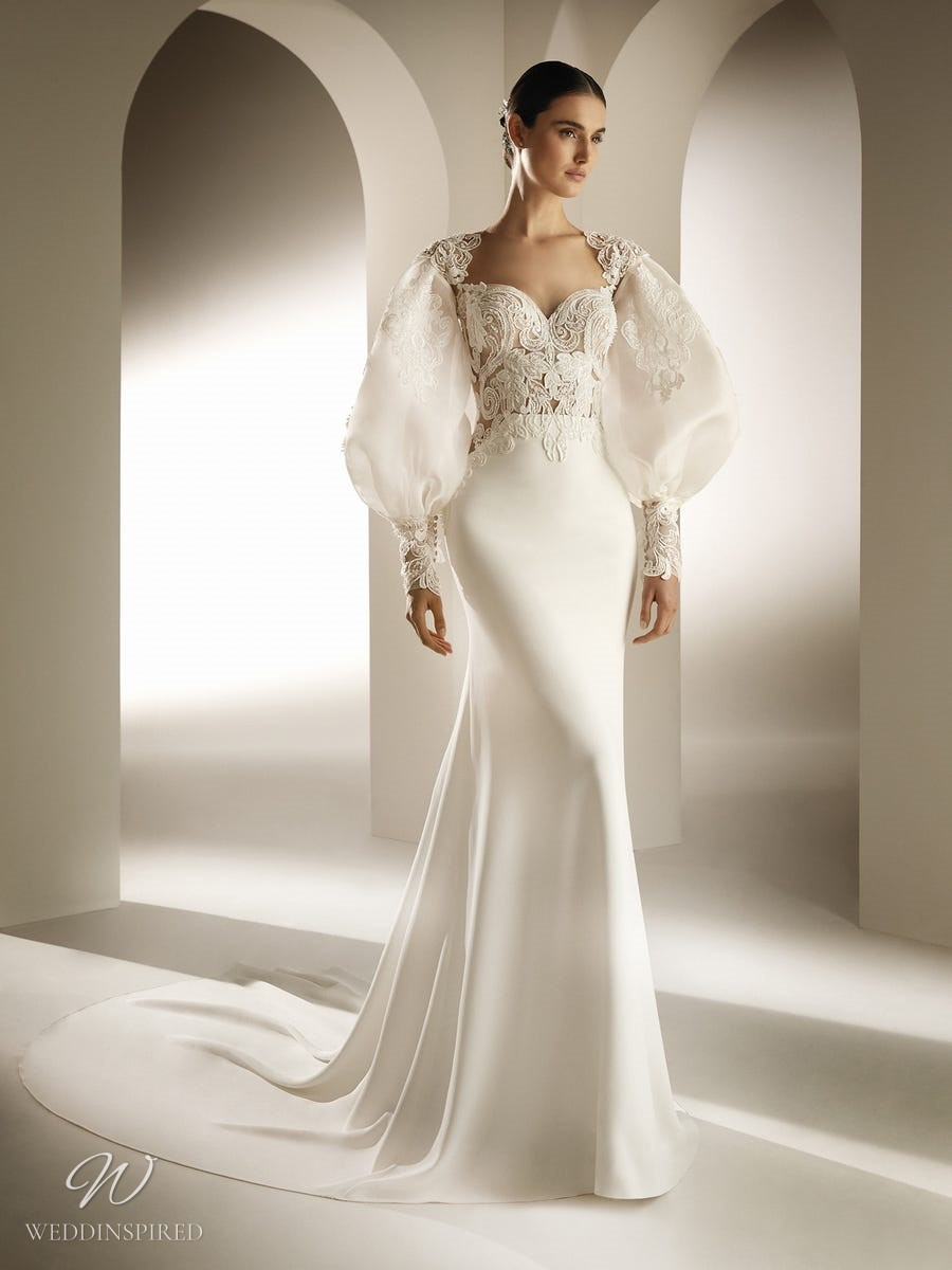An Atelier Pronovias mermaid wedding dress with a lace bodice, long puff sleeves and a train