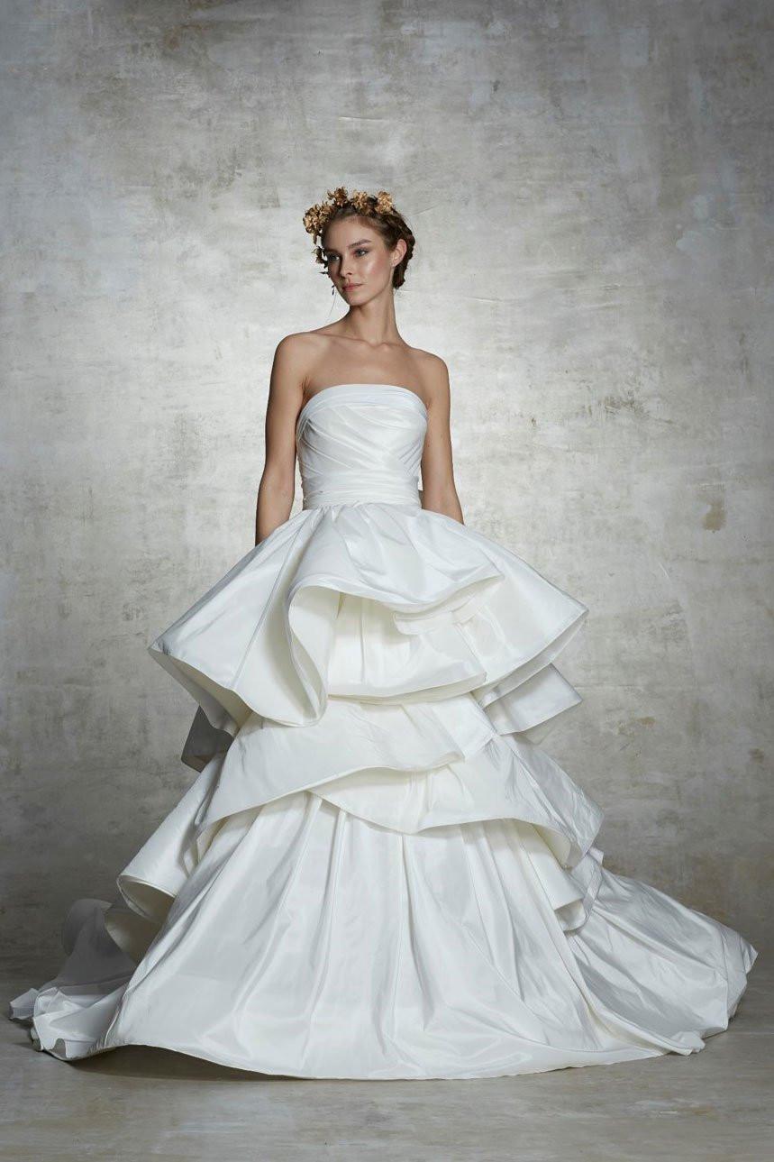 A Marchesa strapless ball gown wedding dress, with a layered skirt