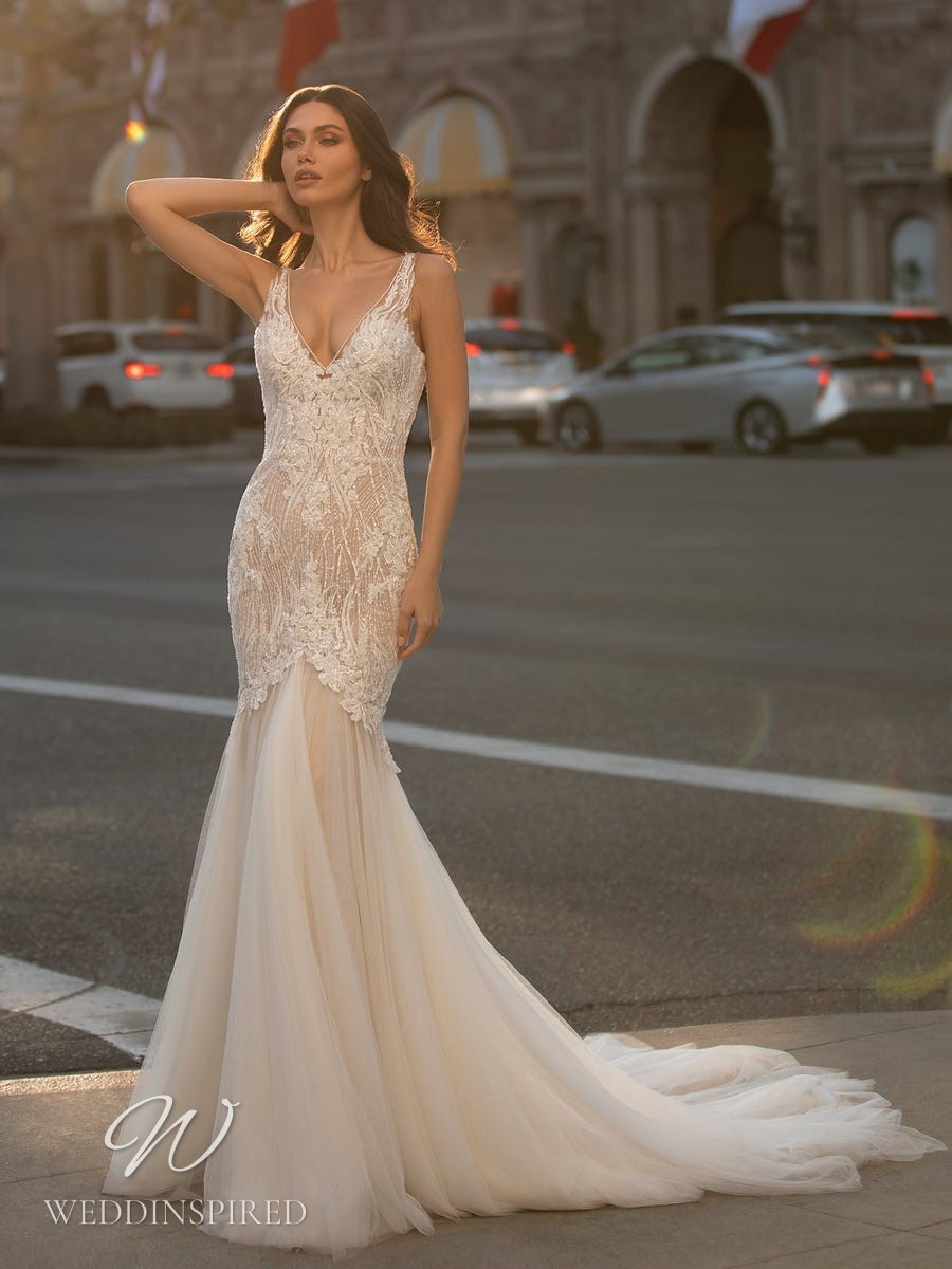 An Ashley Graham x Pronovias 2021 blush lace and tulle mermaid wedding dress with a v neck and straps