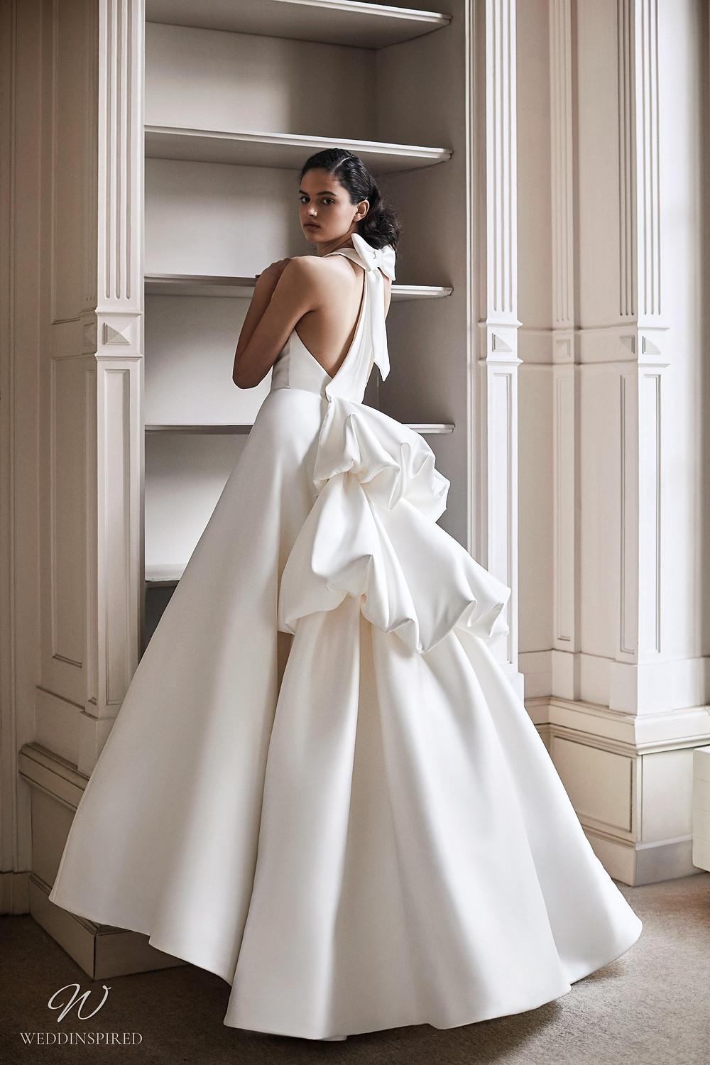 A Viktor & Rolf 2021 princess ball gown wedding dress with ruffles and a bow