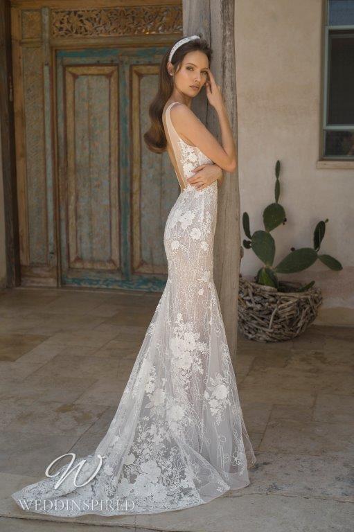 A David Hasbani lace and mesh mermaid wedding dress with a v neckline