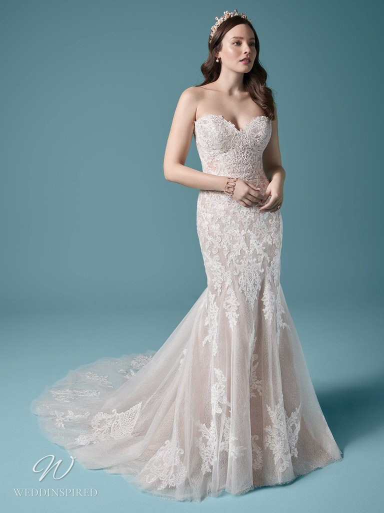 A Maggie Sottero 2021 strapless lace and tulle mermaid wedding dress