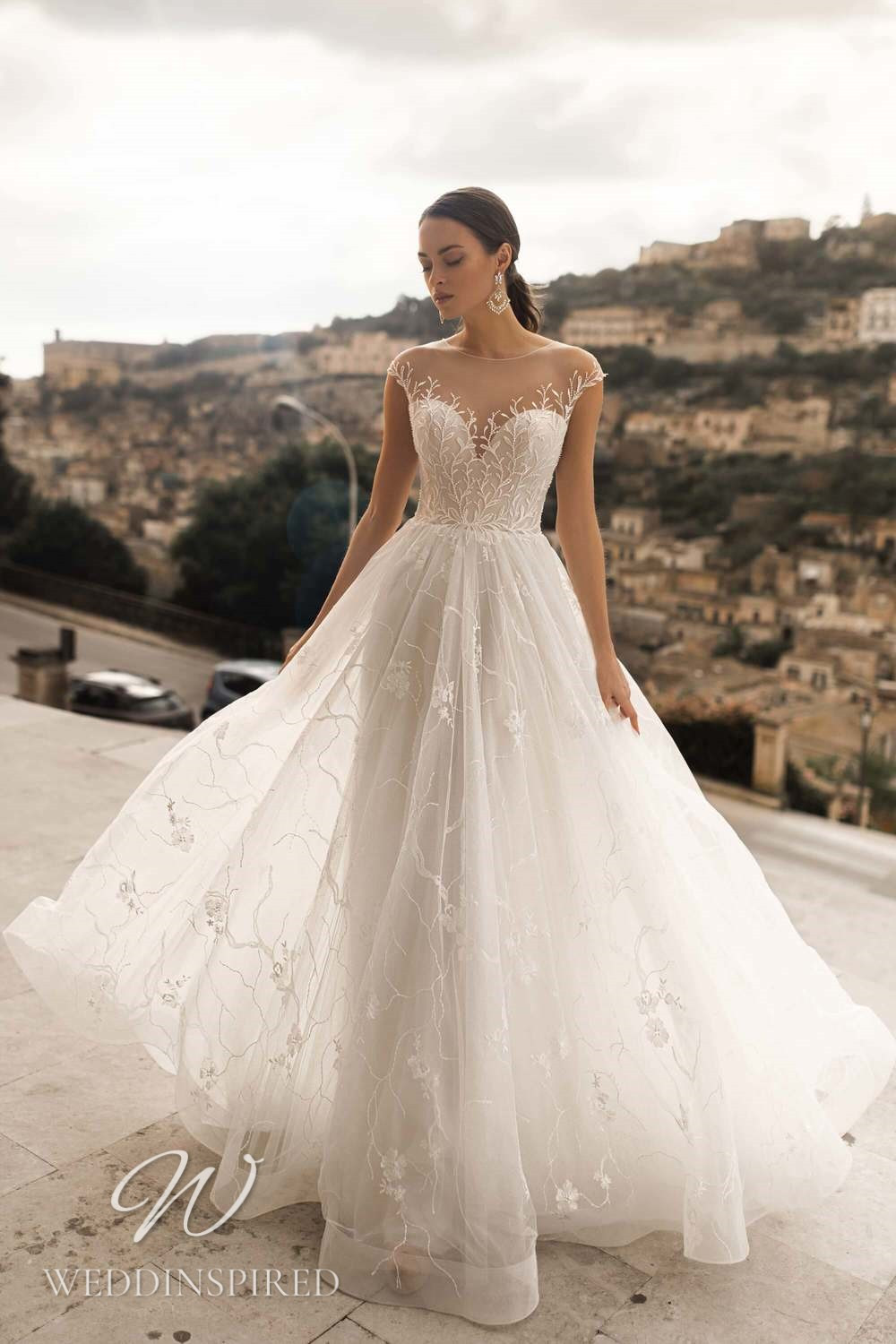 A Lussano 2021 lace and tulle A-line wedding dress with cap sleeves