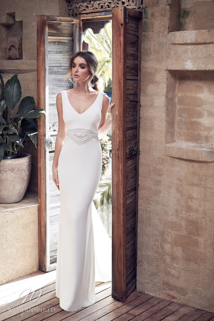 An Anna Campbell 2020 v neck sheath wedding dress with beading