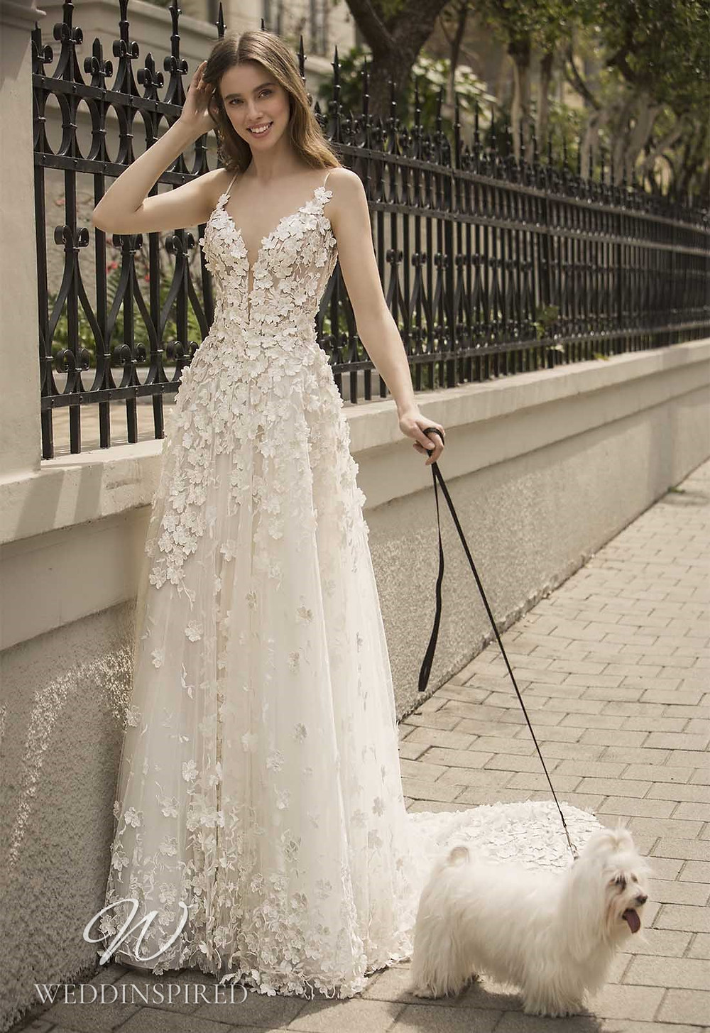 A Pnina Tornai 2021 floral lace and tulle A-line wedding dress