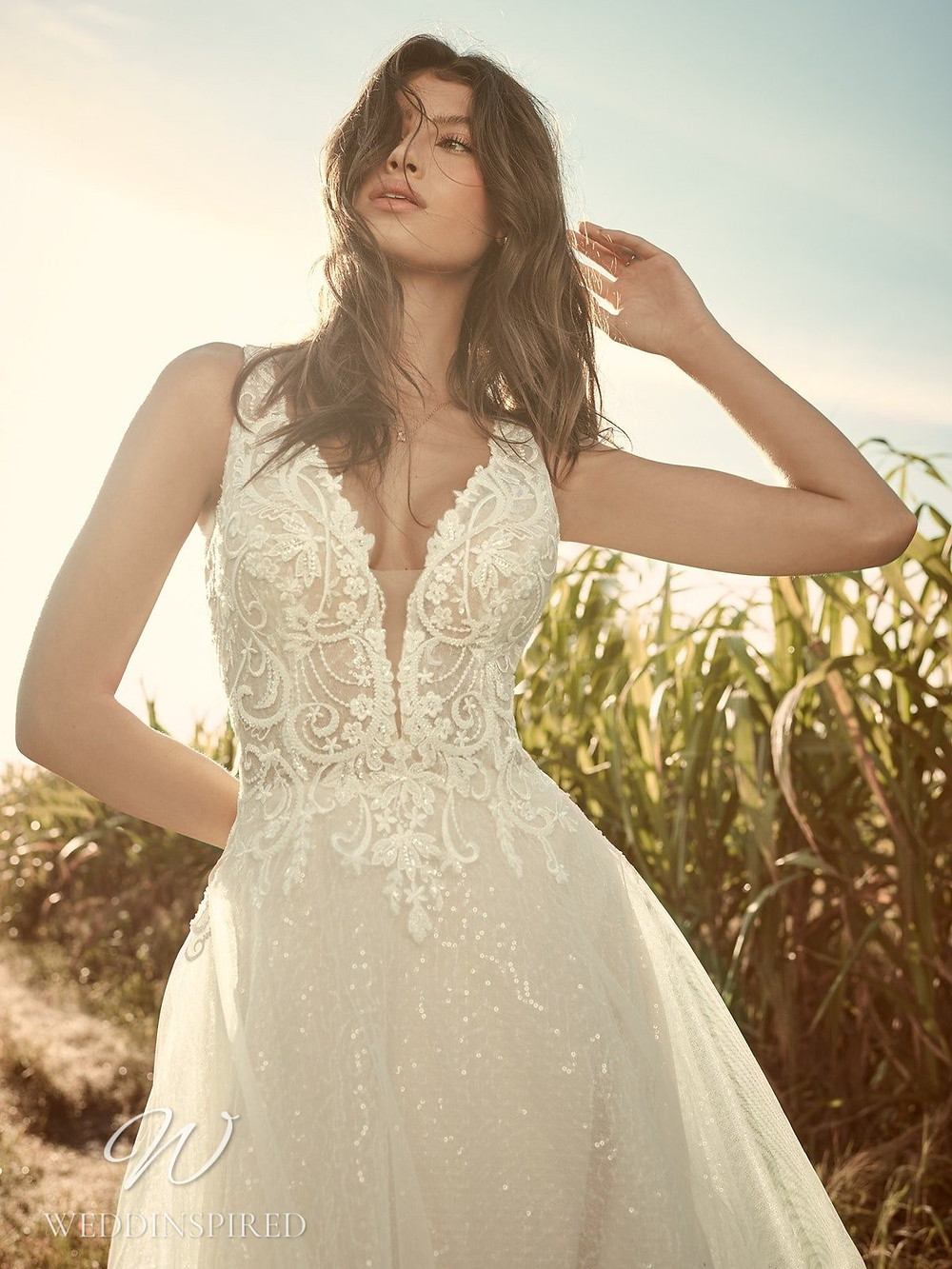 A Rebecca Ingram Spring 2021 sparkly lace and mesh A-line wedding dress with straps and a v neck