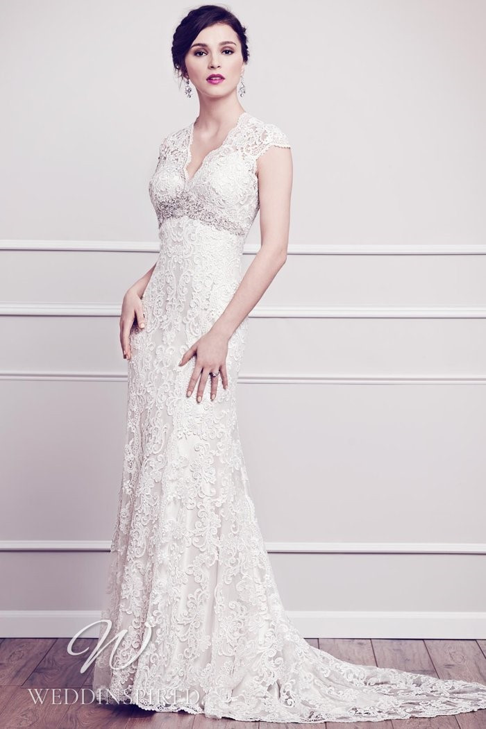 A Kenneth Winston 2021 lace mermaid wedding dress with cap sleeves and a v neck