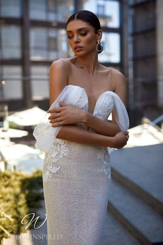 An Ida Torez 2021 off the shoulder beaded mermaid wedding dress