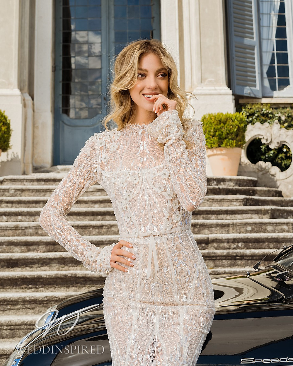 A Berta 2022 modest lace mermaid wedding dress with long sleeves
