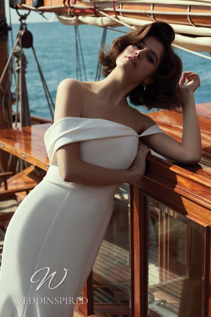 A Justin Alexander 2021 off the shoulder satin mermaid wedding dress
