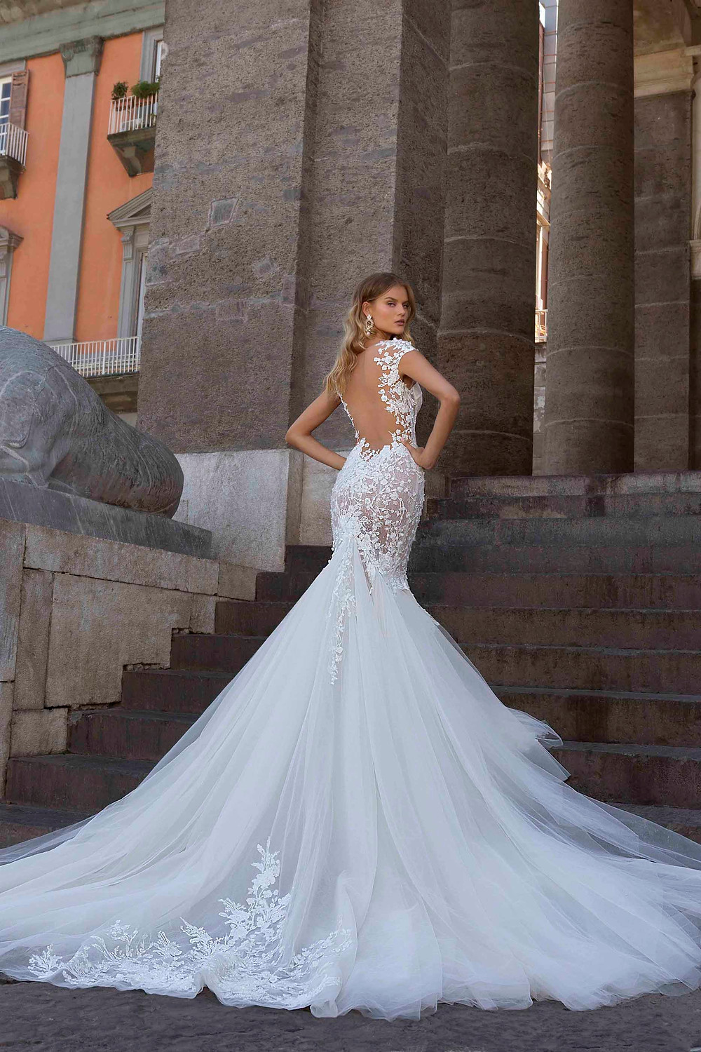 A lace, mermaid wedding dress with tulle skirt and illusion back