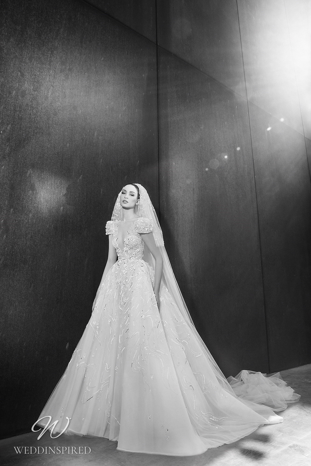 A Zuhair Murad Spring 2022 lace and tulle ball wedding dress with cap sleeves
