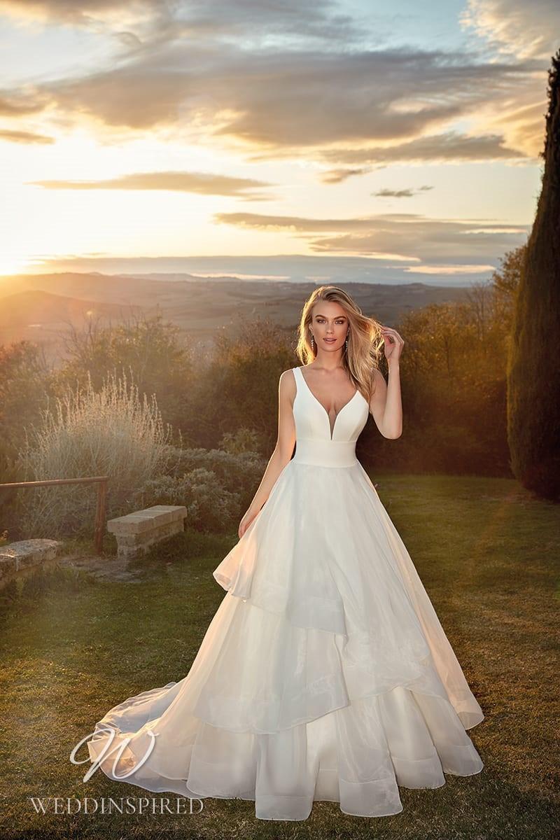 An Eddy K 2021 satin and organza A-line wedding dress with a ruffle skirt