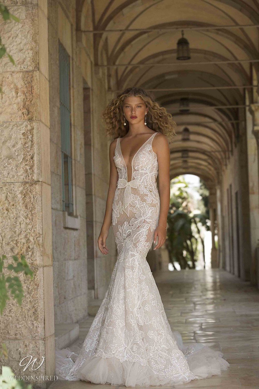 A Berta Colony 2021 lace mermaid wedding dress with a low v neckline and straps