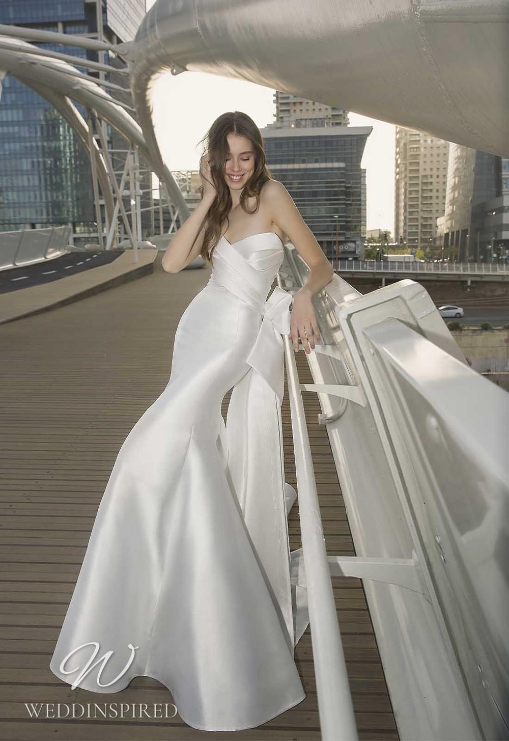 A Pnina Tornai 2021 strapless satin mermaid wedding dress