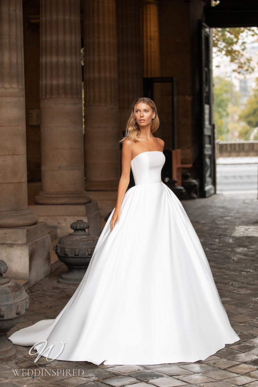 A Milla Nova strapless princess ball gown wedding dress