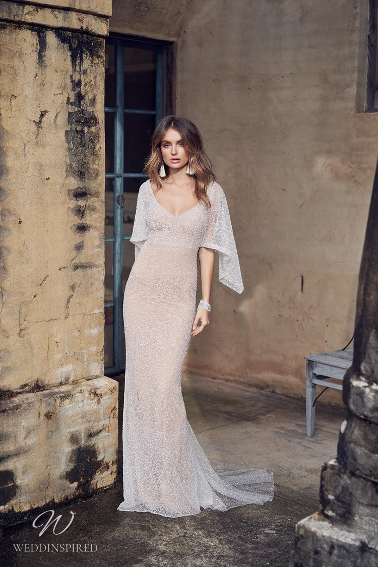 An Anna Campbell 2020 fitted wedding dress with a v neckline, draped sleeves, beading and crystals
