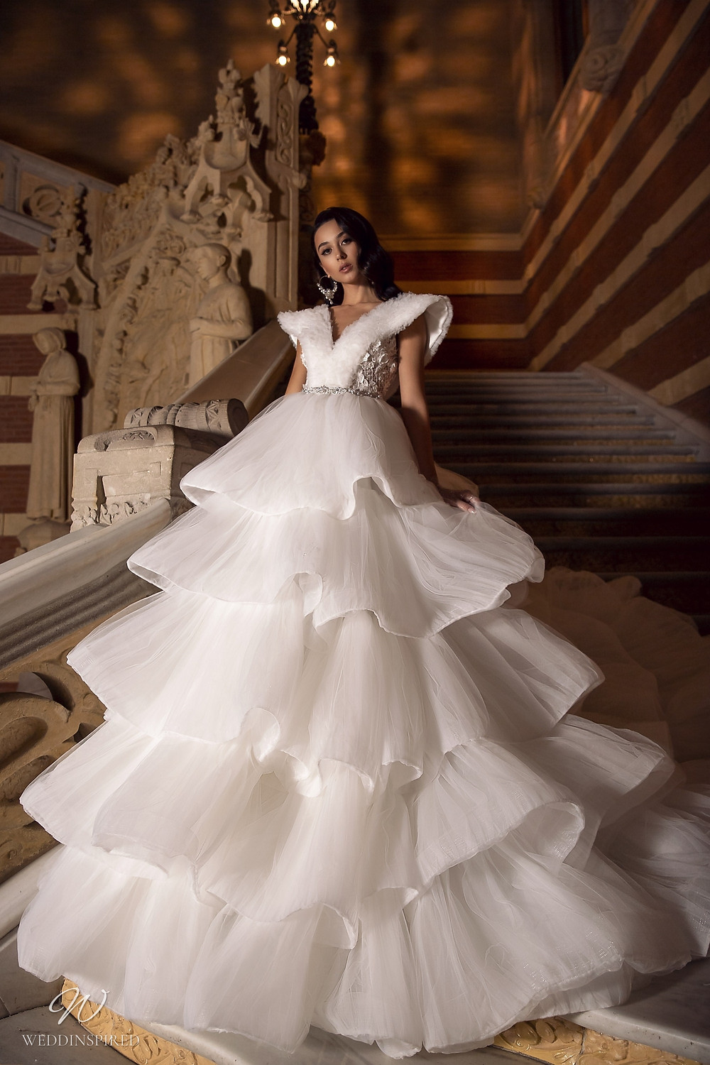 A Maks Mariano ball gown wedding dress with layered ruffle skirt
