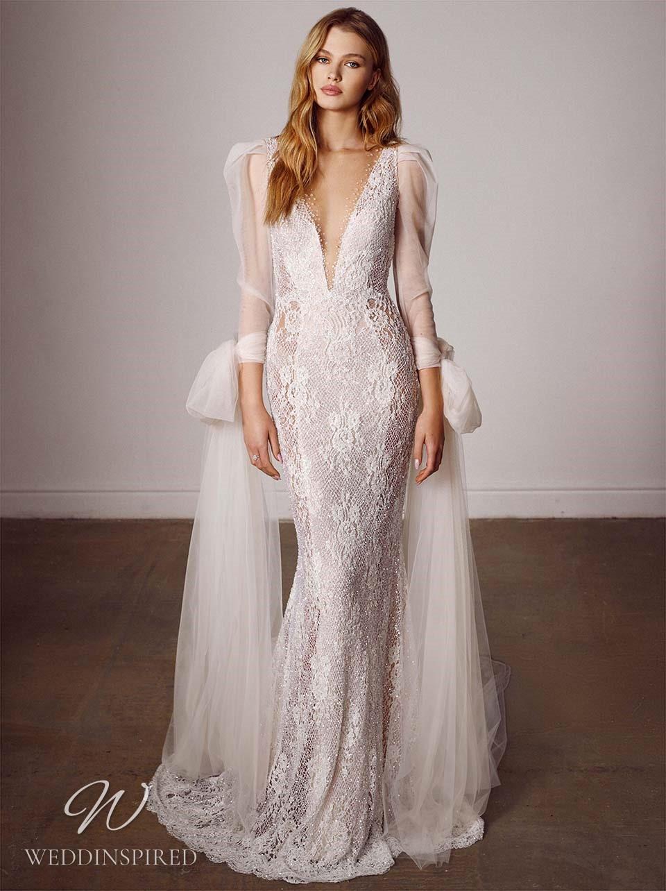 A Galia Lahav 2022 lace mermaid wedding dress with a v neck and long sleeves