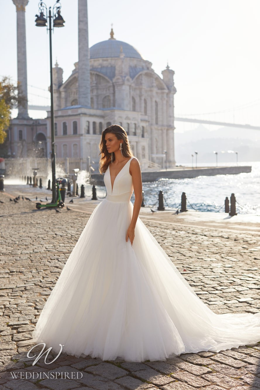 A Milla Nova 2021 satin and tulle ball gown wedding dress with straps and a v neck