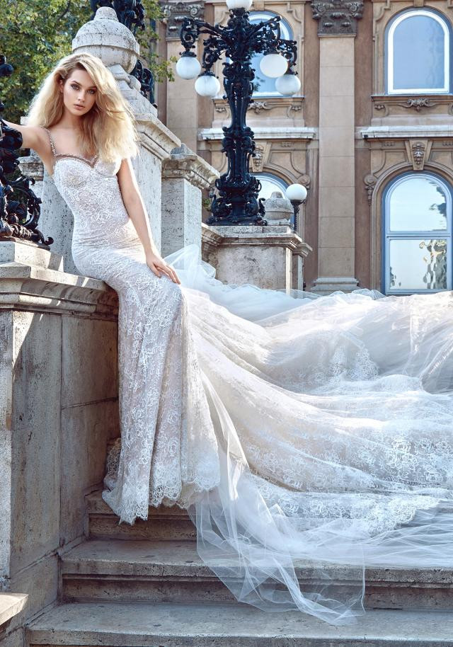 A Galia Lahav lace mermaid fit and flare wedding dress with a long train