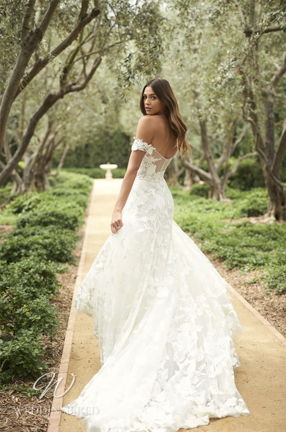 A Monique Lhuillier off the shoulder lace A-line wedding dress